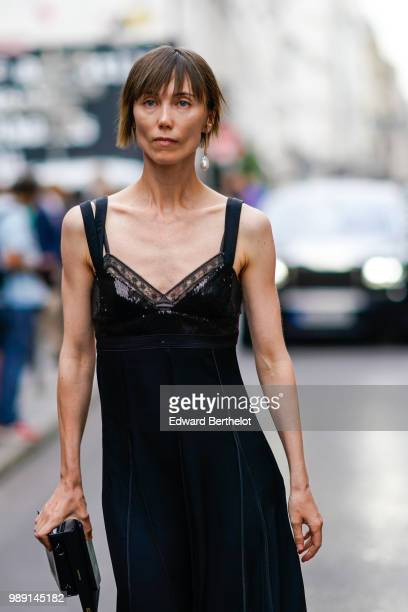 Anya Ziourova wears a black lace dress , outside Givenchy, during Paris Fashion Week Haute Couture Fall Winter 2018/2019, on July 1, 2018 in Paris,...