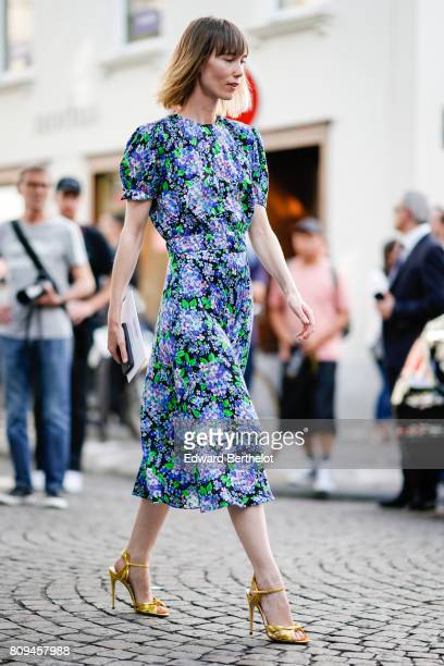 Anya Ziourova wears a flower print blue and green dress and yellow heels shoes outside the Valentino show during Paris Fashion Week Haute Couture...