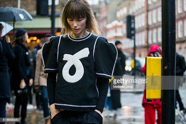 Anya Ziourova wears a JW Anderson puff sleeve tshirt with quilted motif before the JW Anderson show at Yeomanry House during London Fashion Week...