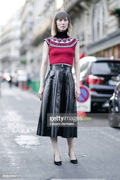 Anya Ziourova wears a red sleeveless top black shoes and a black leather skirt outside the Fendi show during Paris Fashion Week Haute Couture...
