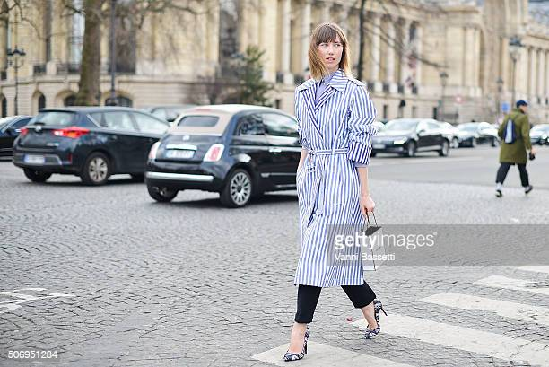 Anya Ziourova wears Celine coat and Pierre Hardy shoes before the Chanel show at the Grand Palais during Haute Couture on January 26 2016 in Paris...