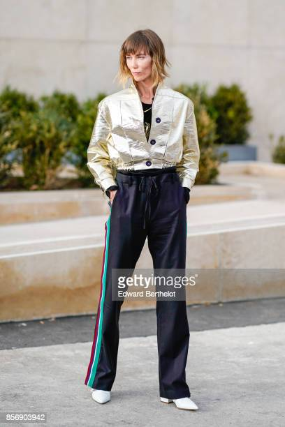 Anya Ziourova wears silver jacket sportswear flare pants outside Hermes during Paris Fashion Week Womenswear Spring/Summer 2018 on October 2 2017 in...