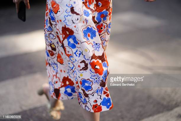 Anya Ziourova wears sunglasses a blue and red floral print dress outside Valentino during Paris Fashion Week Haute Couture Fall/Winter 2019/2020 on...