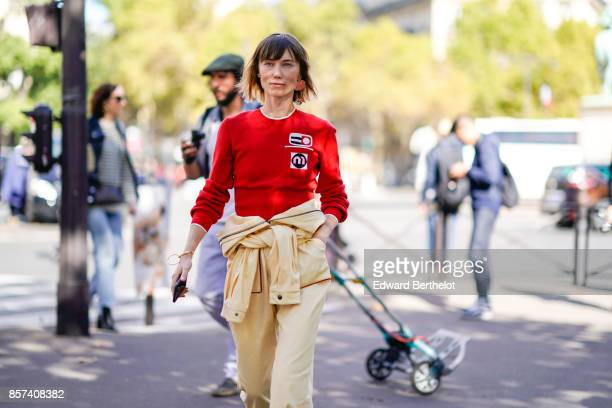 Anya Ziourova weas a red top outside Miu Miu during Paris Fashion Week Womenswear Spring/Summer 2018 on October 3 2017 in Paris France