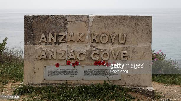 CONTENT] Anzac Cove sign with poppies at Anzac Cove in Gallipoli