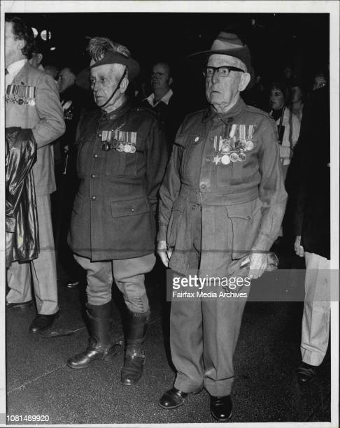 Anzac Day Dawn Service -- Anzac Day veterans l. To r. Charlie Coe, 85 Ted Ringrose, 91 stand at the dawn service. April 25, 1985. .
