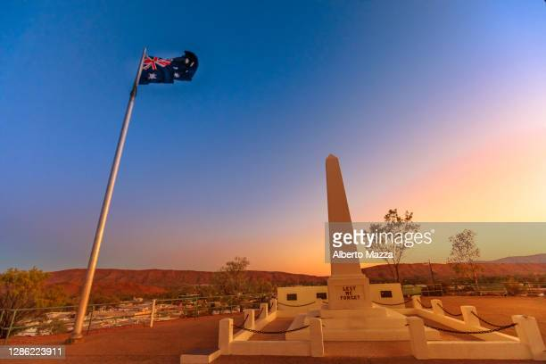 anzac hill memorial australian flag - twilight stock pictures, royalty-free photos & images