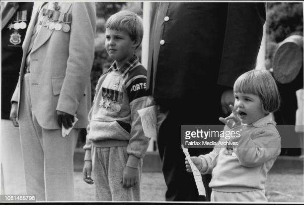 Anzac memorial service at Malabar Children carrying the war medals of their forefathersBrad Wing and his younger sister Nikki April 21 1985
