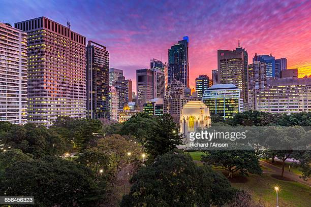 anzac war memorial in hyde park & city at sunset - cenotaph stock pictures, royalty-free photos & images