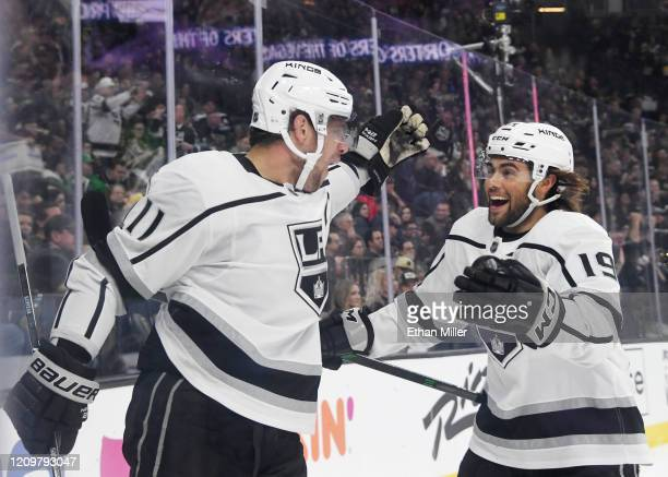 Anze Kopitar and Alex Iafallo of the Los Angeles Kings celebrate after Kopitar scored a power-play goal, his second goal of the first period, against...