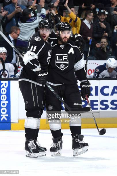 Anze Kopitar and Drew Doughty of the Los Angeles Kings celebrate during a game against the Winnipeg Jets at STAPLES Center on March 23 2017 in Los...