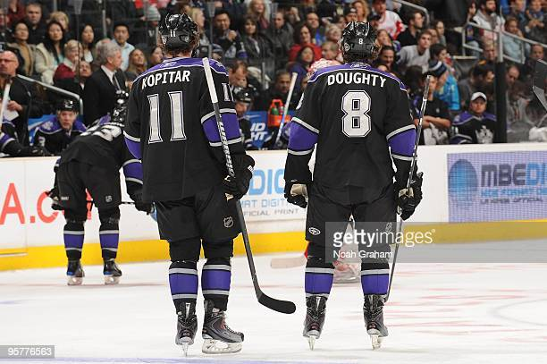 Anze Kopitar and Drew Doughty of the Los Angeles Kings skate to the bench against the Detroit Red Wings on January 7, 2010 at Staples Center in Los...