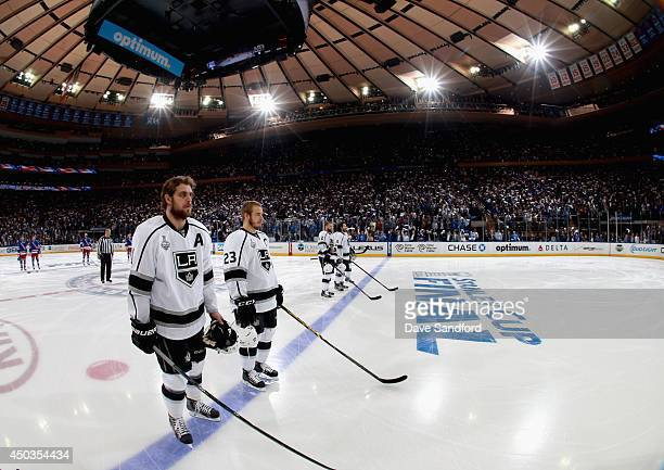 Anze Kopitar and Dustin Brown of the Los Angeles Kings stand on the ice before taking on the New York Rangers in Game Three of the 2014 Stanley Cup...