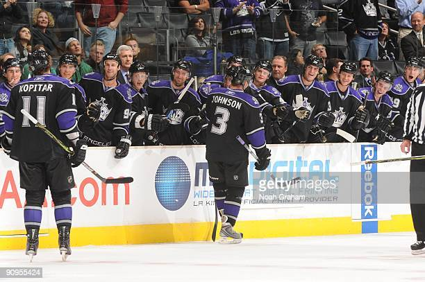 Anze Kopitar and Jack Johnson of the Los Angeles Kings celebrate with the bench against the Phoenix Coyotes on September 15 2009 at Staples Center in...