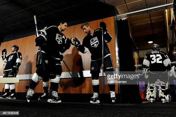 Anze Kopitar and Jeff Carter of the Los Angeles Kings tap gloves outside of the locker room before a game against the Winnipeg Jets at STAPLES Center...