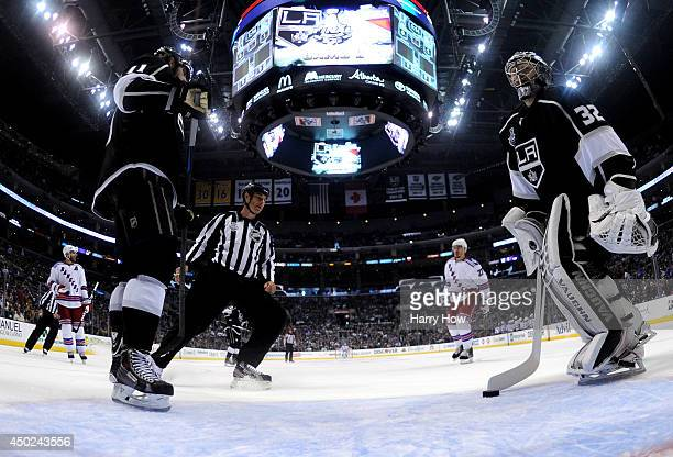 Anze Kopitar and Jonathan Quick of the Los Angeles Kings react after allowing a goal to Mats Zuccarello of the New York Rangers in the first period...