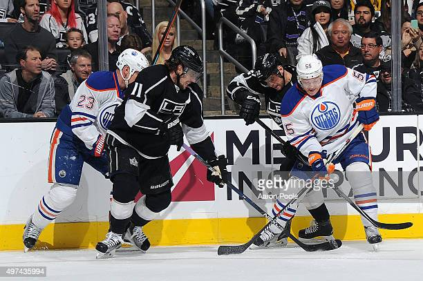 Anze Kopitar and Marian Gaborik of the Los Angeles Kings battle for the puck against Matt Hendricks and Mark Letestu of the Edmonton Oilers at...