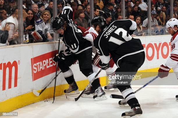 Anze Kopitar and Randy Jones of the Los Angeles Kings battle for the puck in the corner against the Phoenix Coyotes on April 8 2010 at Staples Center...