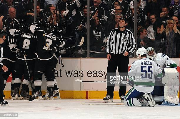 Anze Kopitar, Drew Doughty and Jack Johnson of the Los Angeles Kings celebrate after a goal against Shane O'Brien and Roberto Luongo of the Vancouver...