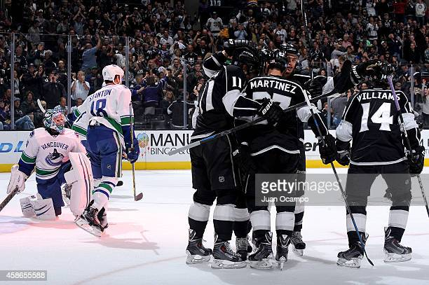 Anze Kopitar Jake Muzzin Alec Martinez and Justin Williams of the Los Angeles Kings celebrate a goal during a game against the Vancouver Canucks at...