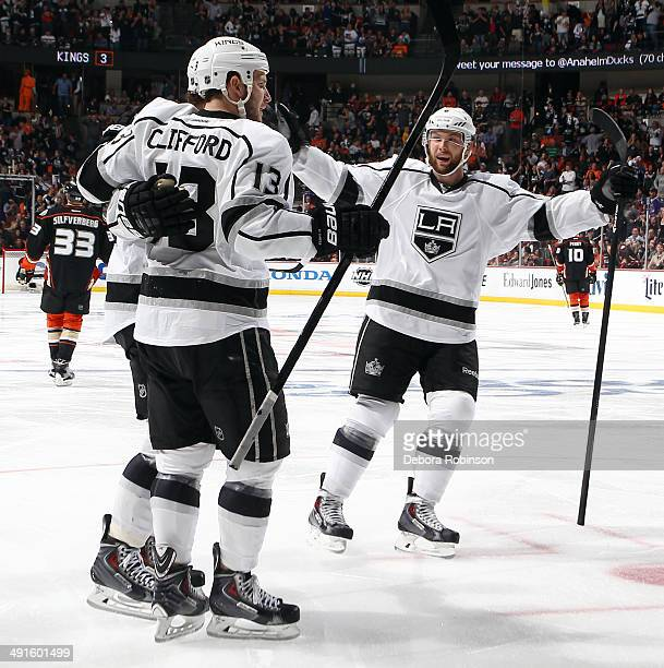 Anze Kopitar Kyle Clifford and Jake Muzzin of the Los Angeles Kings celebrate Koipitar's second period goal against the Anaheim Ducks in Game Seven...
