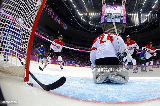 Anze Kopitar of Slovenia scores a goal in the first period against Mathias Lange of Austria during the Men's Ice Hockey Qualification Playoff game on...