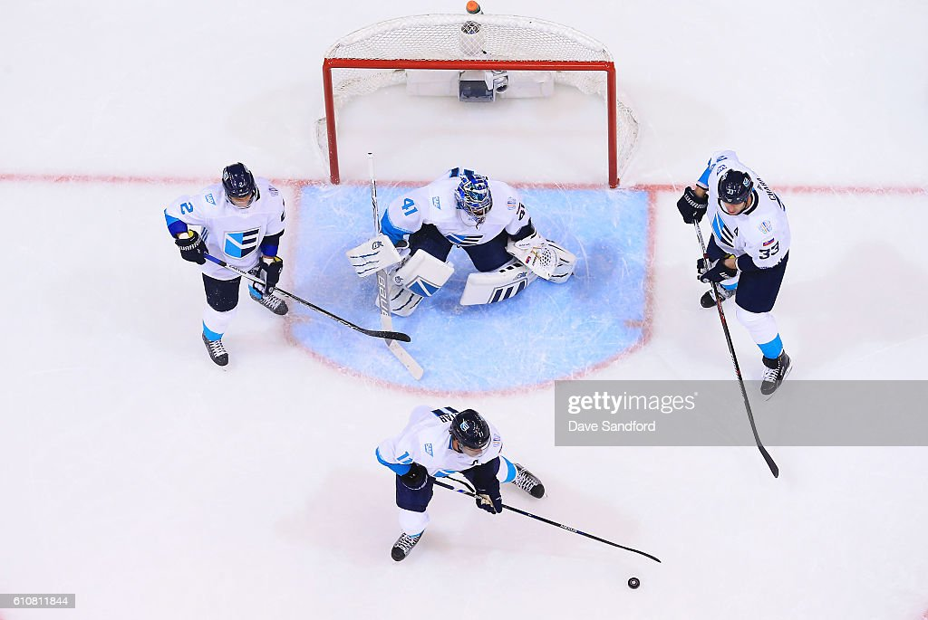 Anze Kopitar #11 of Team Europe clears the puck from the crease as Jaroslav Halak #41 of Team Europe, Zdeno Chara #33 of Team Europe and Andrej Sekera #2 of Team Europe all look on as they face Team Canada during Game One of the World Cup of Hockey 2016 final series at Air Canada Centre on September 27, 2016 in Toronto, Canada.