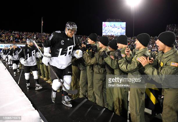 Anze Kopitar of the Los Angeles Kings and his teammates make their way to the ice for the third period of the 2020 NHL Stadium Series game between...