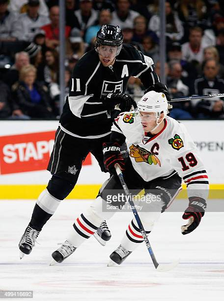 Anze Kopitar of the Los Angeles Kings and Jonathan Toews of the Chicago Blackhawks skate during a game at Staples Center on November 28 2015 in Los...