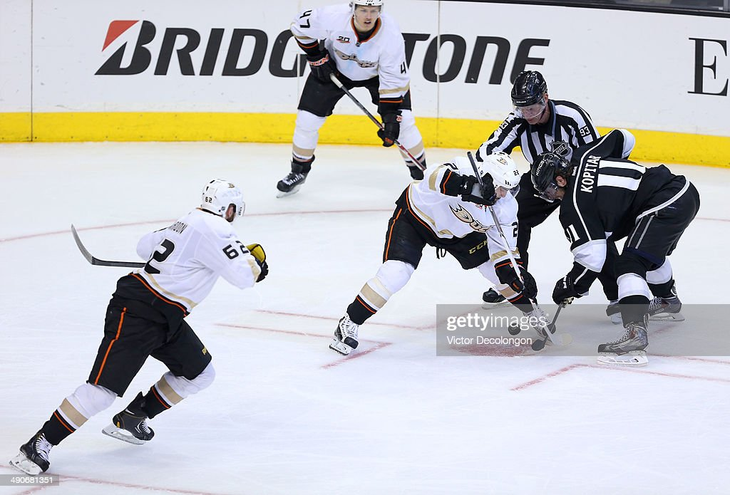 Anze Kopitar #11 of the Los Angeles Kings and Mathieu Perreault #22 of the Anaheim Ducks face off in the Ducks zone during the third period of Game Six of the Second Round of the 2014 NHL Stanley Cup Playoffs at Staples Center on May 14, 2014 in Los Angeles, California.