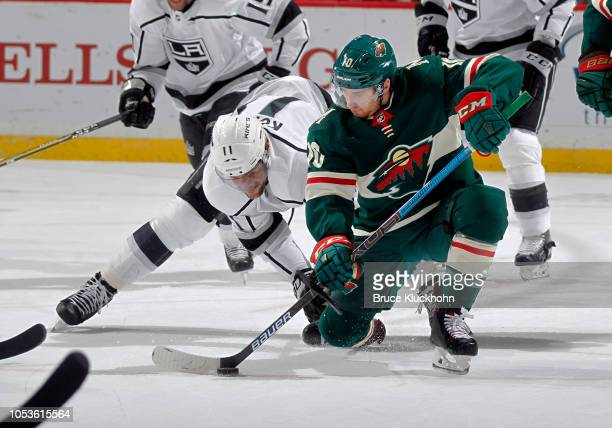 Anze Kopitar of the Los Angeles Kings and Matt Read of the Minnesota Wild battle after a faceoff during a game between the Minnesota Wild and Los...