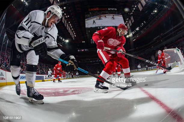 Anze Kopitar of the Los Angeles Kings battles for the puck with Trevor Daley of the Detroit Red Wings during an NHL game at Little Caesars Arena on...