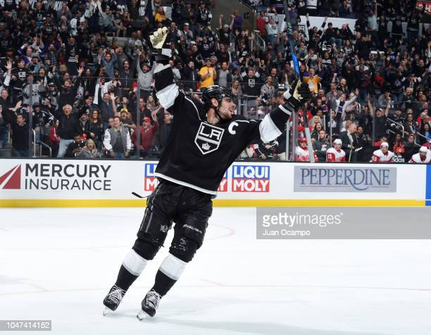 Anze Kopitar of the Los Angeles Kings celebrates a goal by Alex Iafallo not pictured during the third period of the game against the Detroit Red...