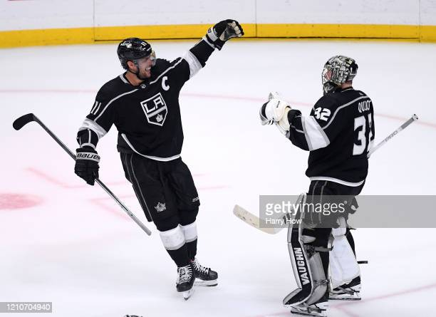 Anze Kopitar of the Los Angeles Kings celebrates an overtime shootout win over the Toronto Maple Leafs with Jonathan Quick at Staples Center on March...
