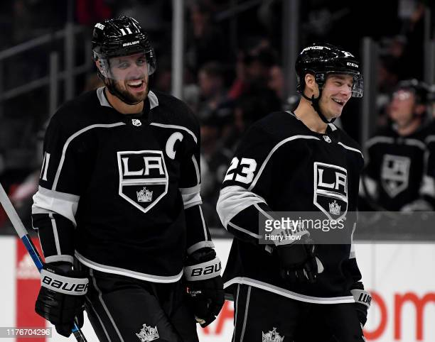 Anze Kopitar of the Los Angeles Kings celebrates his empty net goal with Dustin Brown during the third period in a 3-0 Kings preseason win over the...