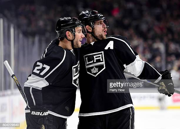 Anze Kopitar of the Los Angeles Kings celebrates his goal with Alec Martinez to take a 10 lead over the St Louis Blues during the second period at...