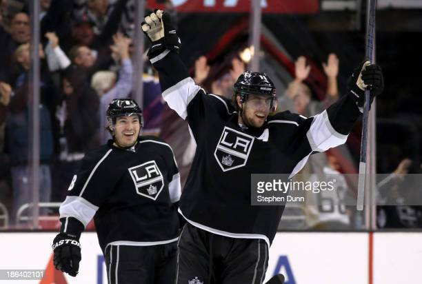 Anze Kopitar of the Los Angeles Kings celebrates with Drew Doughty after Kopitar scored the game winning goal in overtime with an assist from Doughty...
