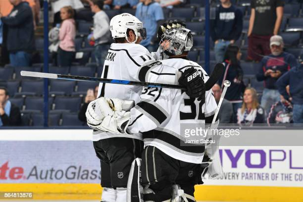 Anze Kopitar of the Los Angeles Kings celebrates with goaltender Jonathan Quick of the Los Angeles Kings after defeating the Columbus Blue Jackets 64...