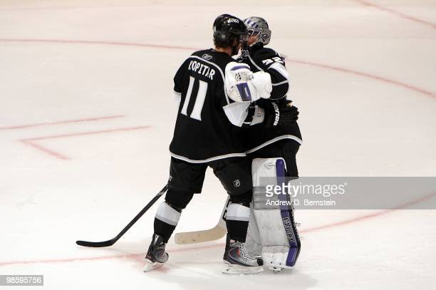 Anze Kopitar of the Los Angeles Kings celebrates with teammate Jonathan Quick after defeating the Vancouver Canucks in Game Three of the Western...