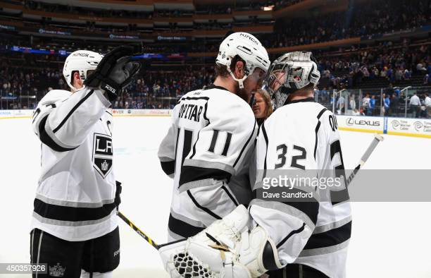 Anze Kopitar of the Los Angeles Kings congratulates goaltender Jonathan Quick of the Los Angeles Kings after the Kings defeated the New York Rangers...