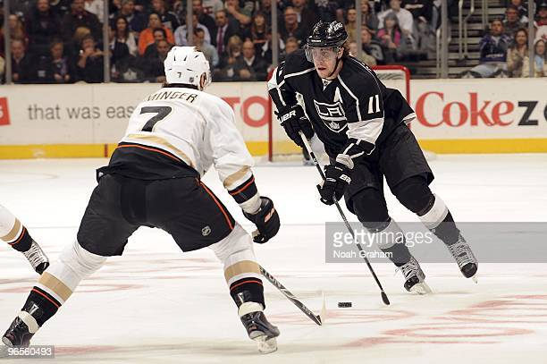 Anze Kopitar of the Los Angeles Kings drives the puck as Steve Eminger of the Anaheim Ducks defends during the game on February 4 2010 at Staples...