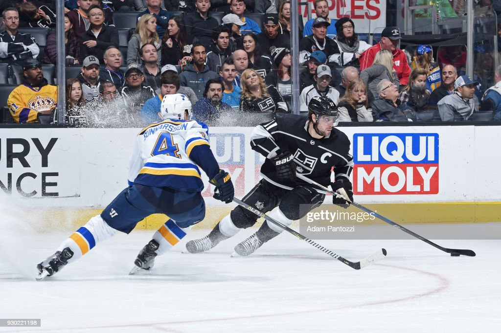 Anze Kopitar #11 of the Los Angeles Kings handles the puck against Carl Gunnarsson #4 of the St. Louis Blues at STAPLES Center on March 10, 2018 in Los Angeles, California.