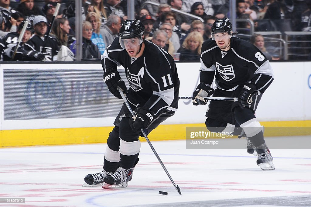 Anze Kopitar #11 of the Los Angeles Kings handles the puck as Drew Doughty #8 of the Los Angeles Kings looks on at STAPLES Center on January 19, 2015 in Los Angeles, California.