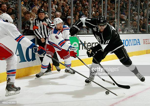 Anze Kopitar of the Los Angeles Kings is defended by Anton Stralman of the New York Rangers in the second period of Game Two of the 2014 Stanley Cup...