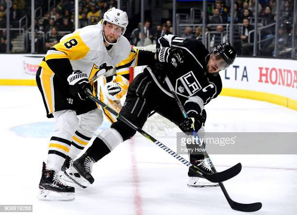 Anze Kopitar of the Los Angeles Kings is knocked off balance by Brian Dumoulin of the Pittsburgh Penguins during the second period at Staples Center...