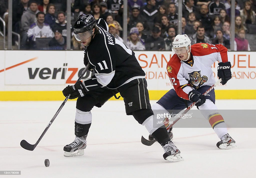 Anze Kopitar #11 of the Los Angeles Kings is pursued by Jack Skille #12 of the Florida Panthers for the puck in the third period at Staples Center on December 1, 2011 in Los Angeles, California. The Kings defeated the Panthers 2-1.