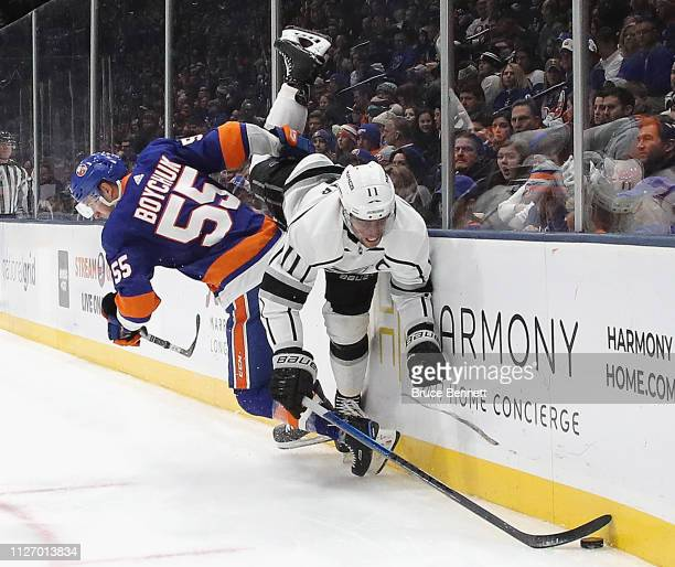 Anze Kopitar of the Los Angeles Kings is tripped up by Johnny Boychuk of the New York Islanders during the first period at NYCB Live's Nassau...
