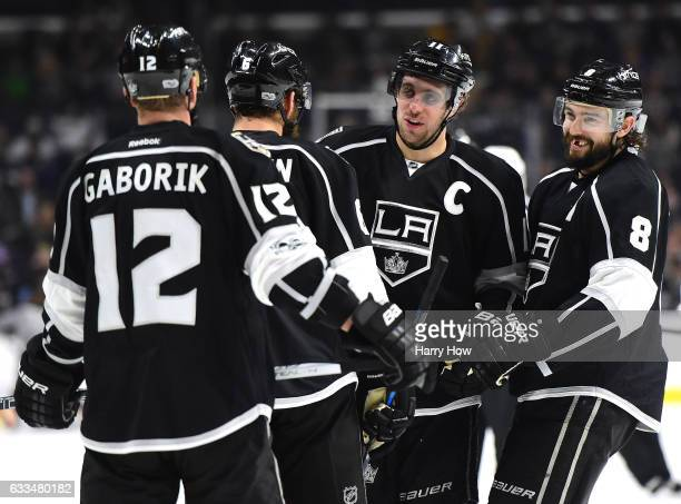 Anze Kopitar of the Los Angeles Kings laughs with Drew Doughty Dustin Brown and Marian Gaborik with a 50 lead over the Colorado Avalanche during the...