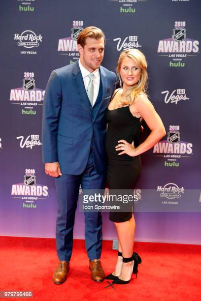 Anze Kopitar of the Los Angeles Kings poses for photos on the red carpet with his wife Ines during the 2018 NHL Awards presented by Hulu at The Joint...