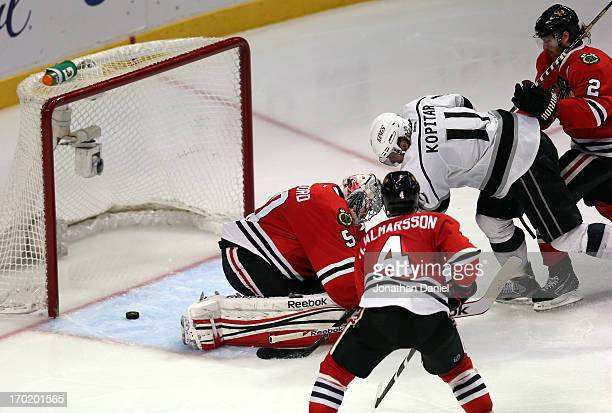 Anze Kopitar of the Los Angeles Kings scores a goal in the third period against goalie Corey Crawford of the Chicago Blackhawks during Game Five of...